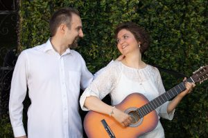 Ekaterina with her husband and guitar